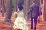 Newly married couple going beginning a journey into the woods, hand in hand